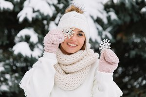 Happy woman in white winter clothes