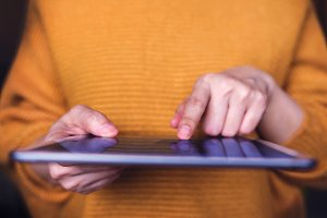 Closeup of a Woman using Tablet