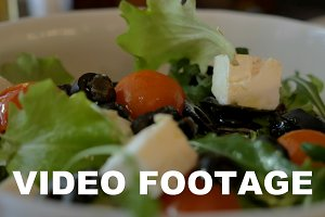 Tossing Greek salad before eating