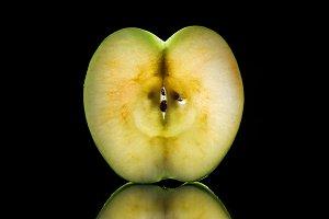 slice of fresh fruit on black