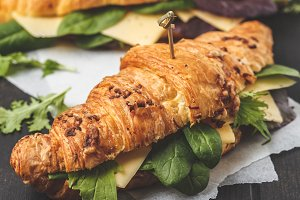 Croissants with cheese and salad