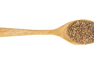 Cumin or caraway seeds in wooden
