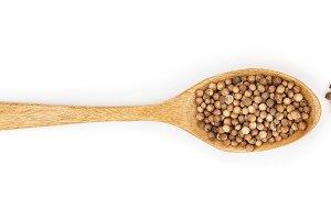 coriander seed in wooden spoon