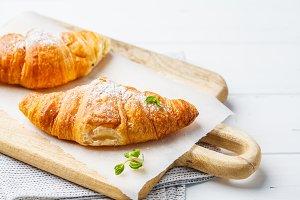 Fresh croissants on white