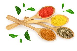 mix of spices in wooden spoon