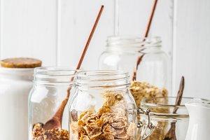 Raw breakfast cereals in glass jars