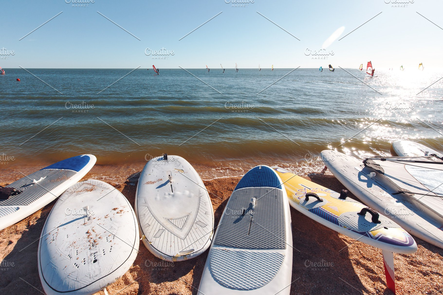 Windsurf boards on the sand at the b