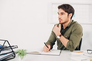 Businessman sitting at desk and thin