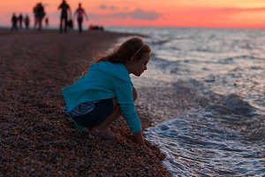 Seven years old girl on the beach at