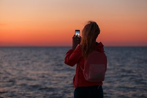 Woman traveler using smartphone and