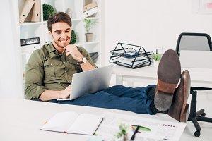 Cheerful businessman sitting on chai