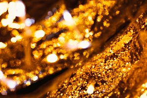 gold and silver bokeh on a dark back