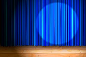 Wooden stage with blue curtain