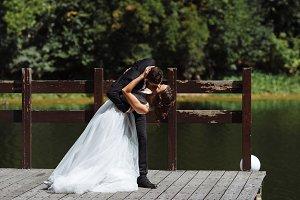 Pretty bride and stylish groom. Geor