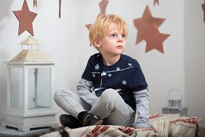 Little boy with blond hair dreams on