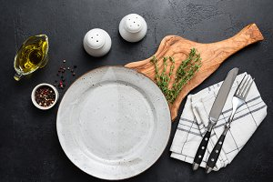Empty plate, cutlery and spices