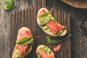 Salmon toast with avocado on wood
