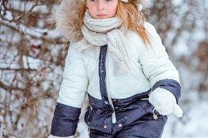 Adorable little girl in frozen winte