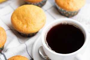 Muffins and cup of black coffee