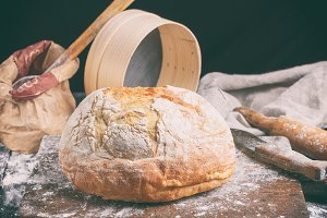 baked round white wheat bread