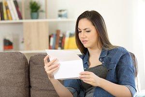 Suspicious female reading a letter
