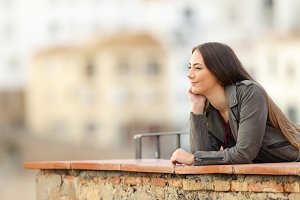 Relaxed woman contemplating views