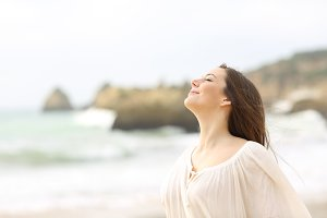 Relaxed lady breathing fresh air
