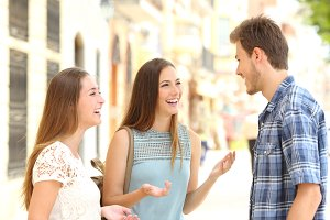 Three smiley friends talking