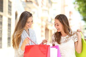 Two shoppers looking at shopping bag