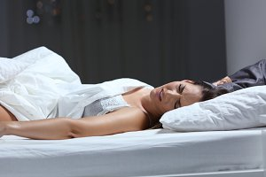Woman having a nightmare in the bed