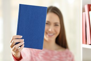 Woman showing a blank cover of book