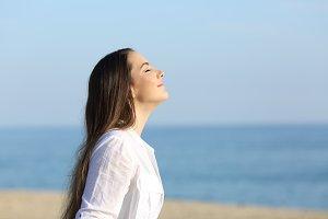 Woman relaxing breathing fresh air o