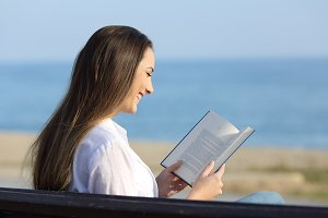 Woman reading a book sitting