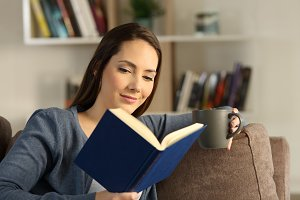 Woman reading a book relaxing  home
