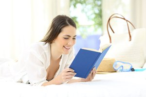 Woman reading a book on summer