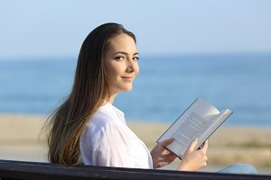 Woman reading a book and looking