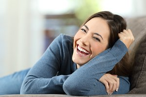 Woman laughing with perfect teeth
