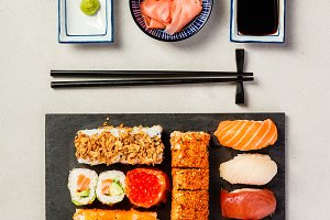 Flat-lay of sushi set on grey concre