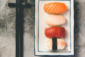 Flat-lay of sushi on a grey stone ba
