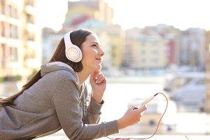 Dreamer girl listening to music