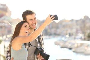 Couple taking selfies on summer