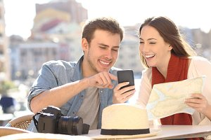 Couple of tourists comparing online