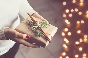 Girl holds a gift box