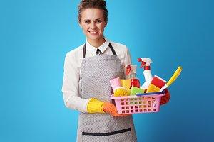 scrubwoman with basket with detergen