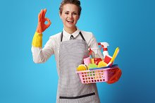 housemaid with a basket with deterge