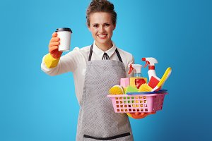 housemaid with a basket with cleanse