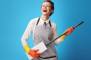 happy young cleaning woman in apron