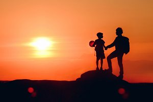 Dad and boy with balloon