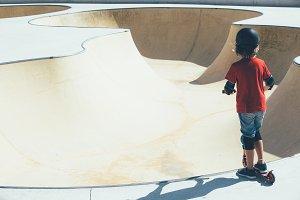 Child in the urban skate park