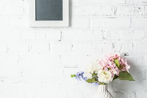 blank frame on white brick wall with